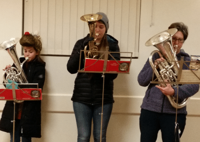 Brass band players at Christmas entertaining locals with carols.