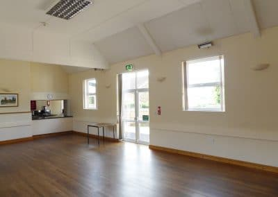 The inside of Ravensthorpe Village Hall showing kitchen through serving hatch.