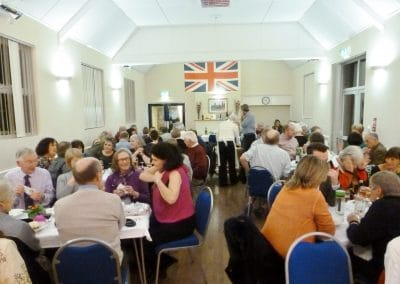 Food rinks and friends coming together for a celebration at Ravensthorpe Village Hall.