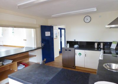 Ravensthorpe Village Hall kitchen with serving hatch and good cooking facilities.